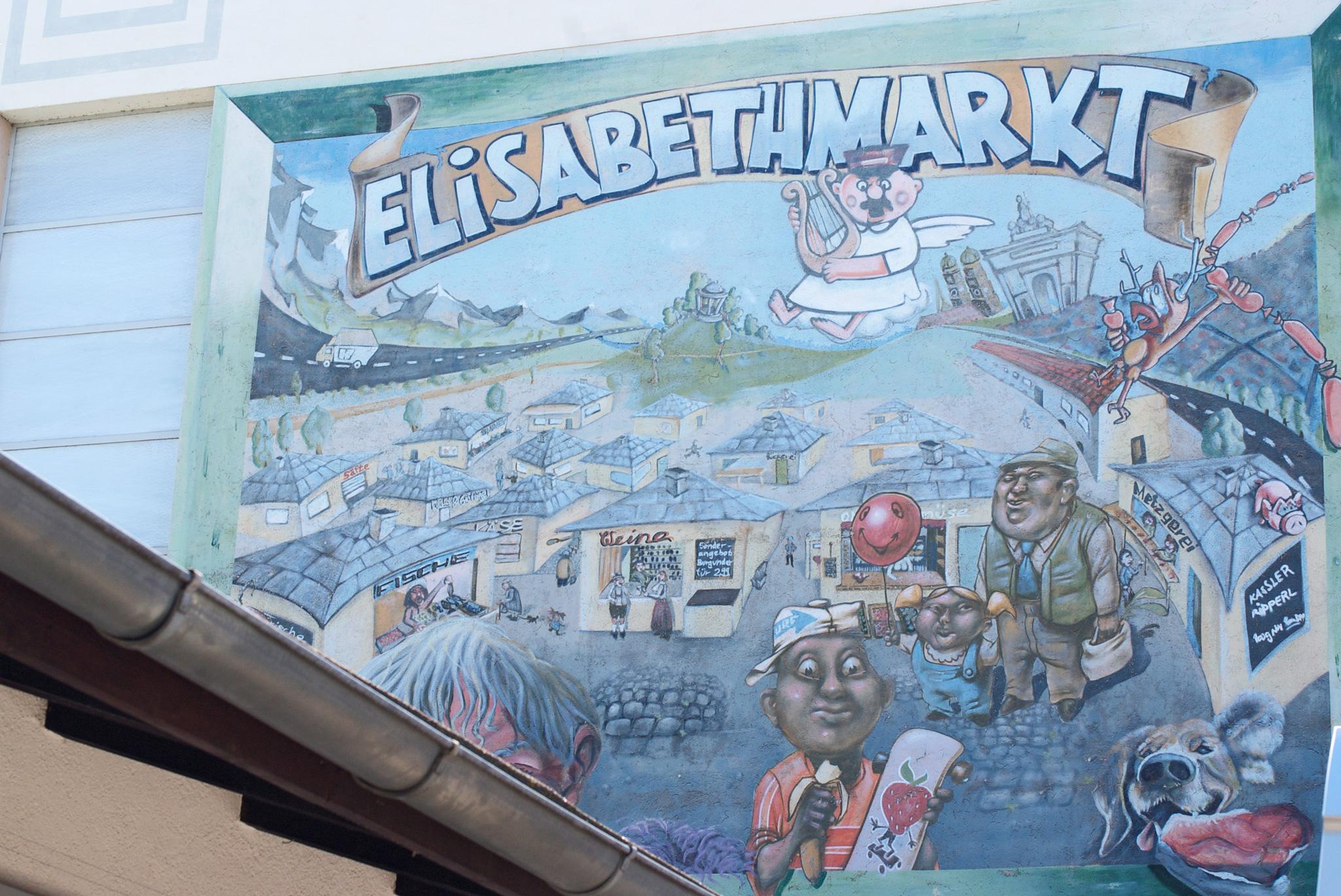 Der Elisabethmarkt in Schwabing als Karikatur